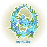 Oeufs de pâques et oublier-moi cadre de fleurs Photographie stock libre de droits