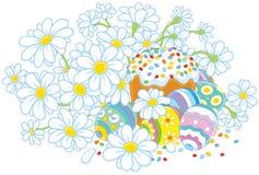 Oeufs de pâques et un gâteau avec des fleurs Images libres de droits