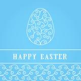 Oeufs de pâques heureux blancs sur un bleu Photographie stock libre de droits