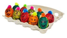 Oeufs de pâques, peints à la main avec sourire et le fac terrifié de bande dessinée Images libres de droits