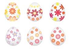 Oeufs de pâques peints avec des fleurs Photos stock