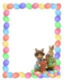 Oeufs et lapins de cadre de Pâques Photographie stock