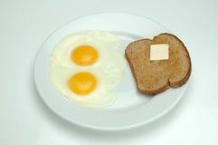 Oeufs et pain grillé Images libres de droits