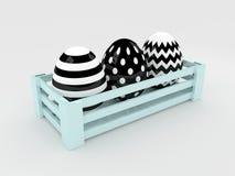 oeufs noirs et blancs de 3d pâques dans la boîte en bois Photos libres de droits