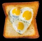 Oeufs sur le plat de caille dans un pain grillé Image libre de droits