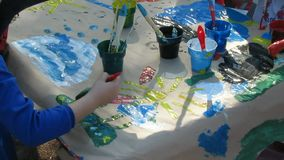 Oeuvre. Children`s Creativity. So Children Draw. Children draw together on one large sheet of paper stock footage