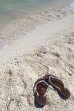 Oever met sandals. Stock Afbeelding