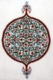 Oezbekistaans borduurwerk op een muur stock fotografie