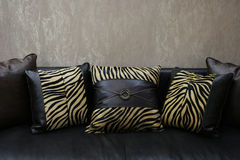 Ofa with print cushions Royalty Free Stock Images