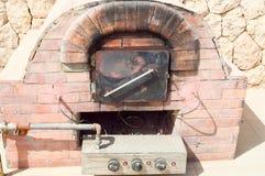 Ofen, Stein, Feuer, der Kamin, kochend, Ziegelstein, Lebensmittel, Hitze, Holz, Ofen, Italiener, Pizza, die Mahlzeit, alt, tradit Lizenzfreie Stockfotos