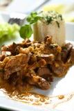 Ofenschweinefleisch mit Reis Stockbild