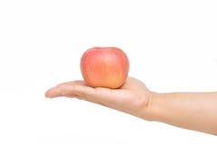 Oferecendo uma maçã Fotografia de Stock Royalty Free