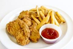 Ofertas y fritadas del pollo Foto de archivo