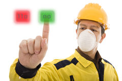 ON or OFF. Worker pressing the On button Royalty Free Stock Photo