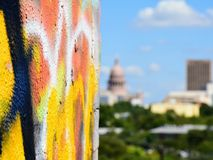 Graffiti wall with the Texas State Capitol blurred in Background royalty free stock photography