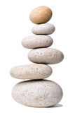 Off-balanced Stones. A stack of slightly off-balanced zen stones isolated on white background Stock Photography