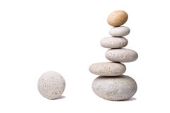 Off-balanced Stones. A stack of slightly off-balanced zen stones isolated on white background Royalty Free Stock Images