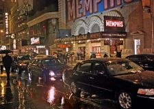 Off Broadway Shows, New York. 23 Nov 2011. Rainy night in the theatre district of New York. Cars waiting to pick up patrons soon to emerge from the last show royalty free stock image