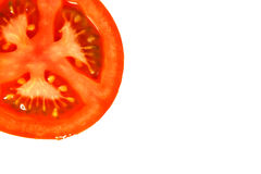 Off Centre Tomato. A tomato that has been sliced in half and composed slightly out of frame royalty free stock images