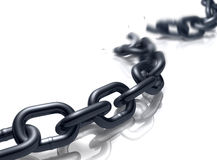 Off the Chain. Heavy duty chain on a reflective floor breaking Stock Photo