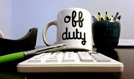 Off Duty Coffee Mug in Office Royalty Free Stock Images