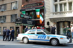 Off duty New York Police get ready for Parade. St. Patrick's Day celebrations include the big parade. New York City police and fire departments traditionally Royalty Free Stock Photos