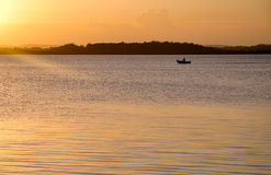 Off fishing. A lone boat heads out fishing at Redland Bay just south of Brisbane, Australia Stock Photos