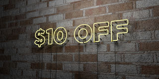 $10 OFF - Glowing Neon Sign on stonework wall - 3D rendered royalty free stock illustration. Can be used for online banner ads and direct mailers Stock Photos