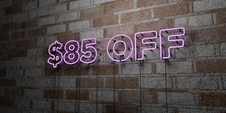 $85 OFF - Glowing Neon Sign on stonework wall - 3D rendered royalty free stock illustration. Can be used for online banner ads and direct mailers Stock Photos