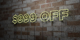 $999 OFF - Glowing Neon Sign on stonework wall - 3D rendered royalty free stock illustration. Can be used for online banner ads and direct mailers Royalty Free Stock Images