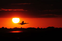Off we go!. Plane taking off at dusk Stock Images