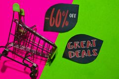 60% Off and Great Deals Text and Shopping cart. Discount and promotion business concept on colorful background. N royalty free stock photo