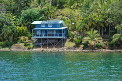 Off grid coastal home with lush vegetation Royalty Free Stock Photo