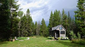 Off grid tiny house in the mountains. Off grid tiny house that is lived in full time in the mountains of Wyoming Stock Photos