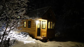 Off grid Winter Tiny House Royalty Free Stock Image