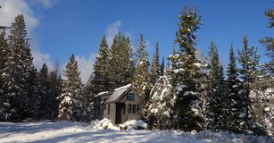 Off grid Winter Tiny House Royalty Free Stock Photography