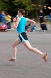Off the Ground Female Runner Stock Photo