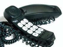 Off the hook. Green corded phone with large number keypad royalty free stock images