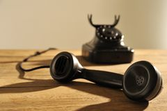 Off the hook telephone. Can someone answer me please ! The speaker is in focus, short d.o.f Royalty Free Stock Photos