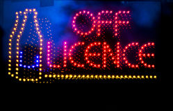 Off licence liquor store neon light sign Royalty Free Stock Photos