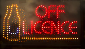 Off licence liquor store neon light sign Royalty Free Stock Images