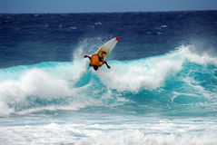 Off the lip!. A surfer doing a back side off the lip stock image
