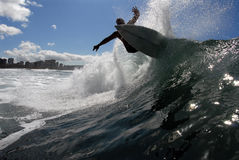 Off the lip. A shortboarder surfing hitting the lip royalty free stock photography