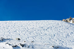 Off piste ski tracks on powder snow Royalty Free Stock Image