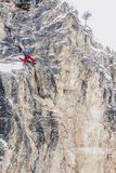 Off-piste skiers are practicing rock climbing royalty free stock photography