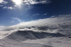 Off-piste slope in clouds Royalty Free Stock Image