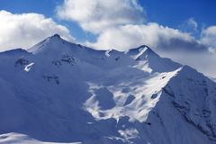 Off piste slope for heliskiing and helicopter in evening Royalty Free Stock Photo