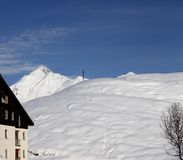 Off-piste slope and hotel in winter mountains Royalty Free Stock Images