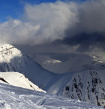 Off-piste slope and mountains with storm clouds Royalty Free Stock Image