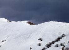 Off piste slope and overcast gray sky in windy day Royalty Free Stock Photos
